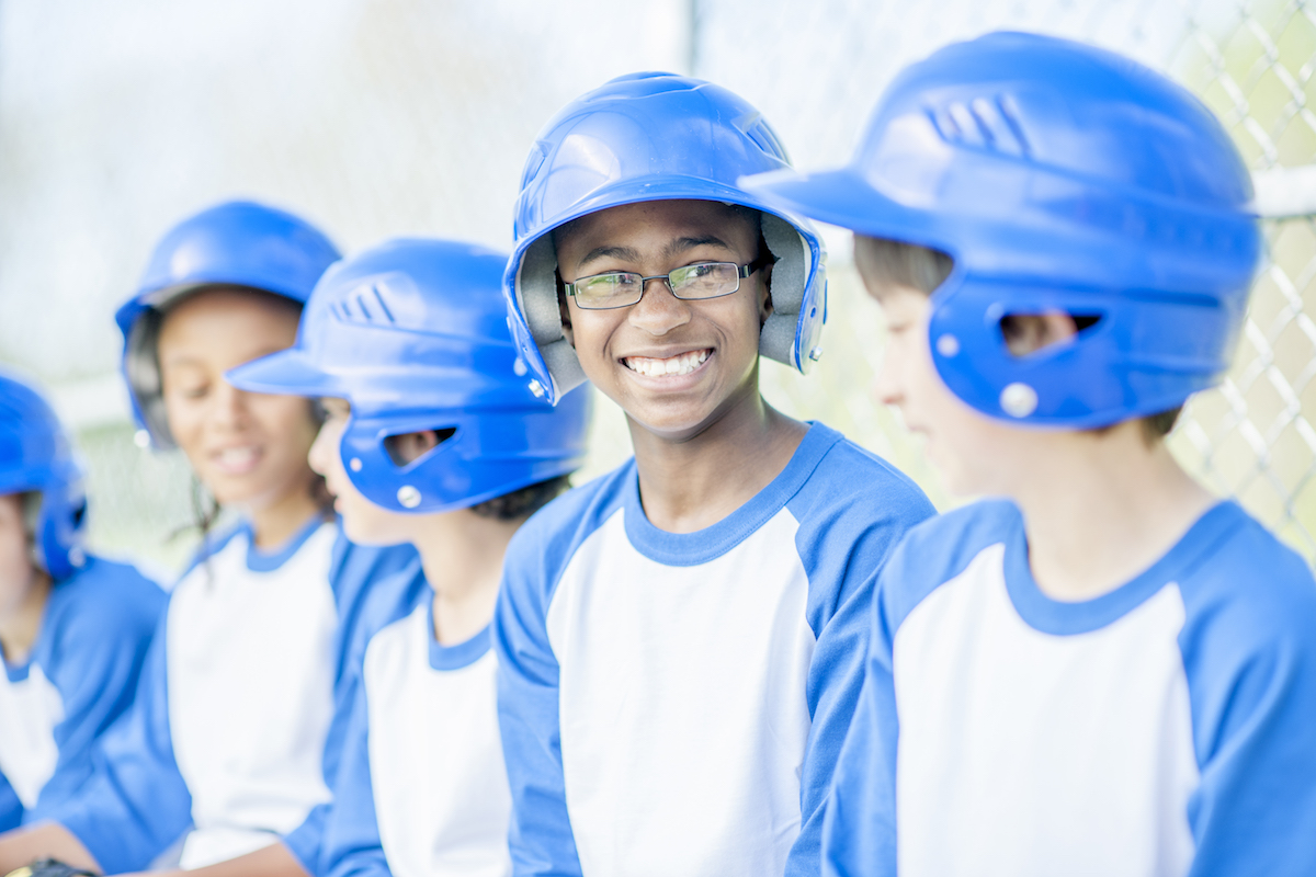 young baseball players wearing sports goggles