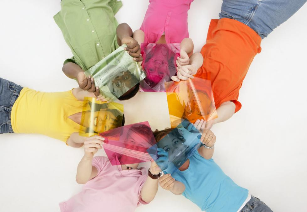Kids in a circle holding color transparencies