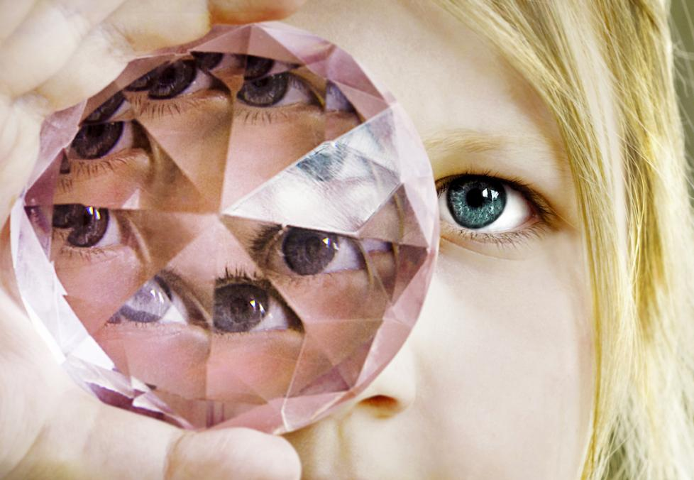 woman staring into a diamond